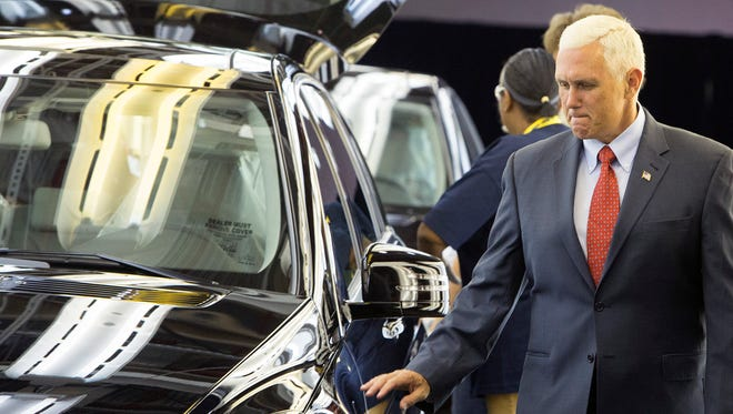 Then-Indiana Gov. Mike Pence takes a look at a Mercedes-Benz R-Class fresh off the line at AM General's Commercial Assembly Plant, Tuesday, Aug. 11, 2015, in Mishawaka, Ind.