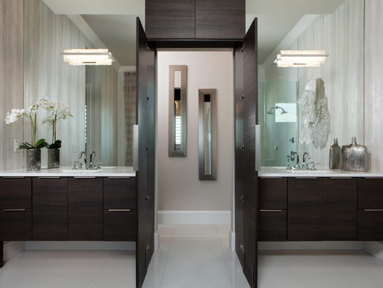 Double doors in the master bathroom lead to a secret