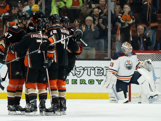 Anaheim Ducks defenseman Hampus Lindholm (47), of Sweden, celebrates his goal with teammates as Edmonton Oilers goaltender Cam Talbot, right, looks away during the first period of an NHL hockey game in Anaheim, Calif., Friday, Feb. 9, 2018. (AP Photo/Alex Gallardo)