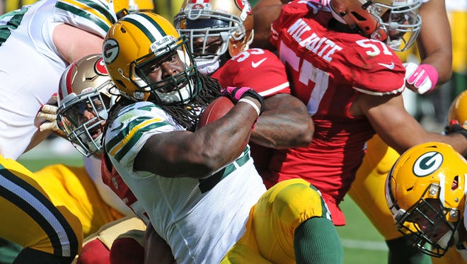 Green Bay Packers running back Eddie Lacy runs for a first down in the second quarter against the San Francisco 49ers at Levi's Stadium.
