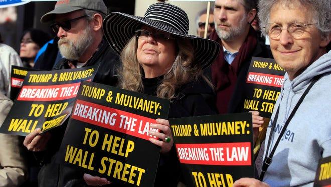 Protester outside the Consumer Financial Protection Bureau headquarters in Washington, on Nov. 28, 2017.