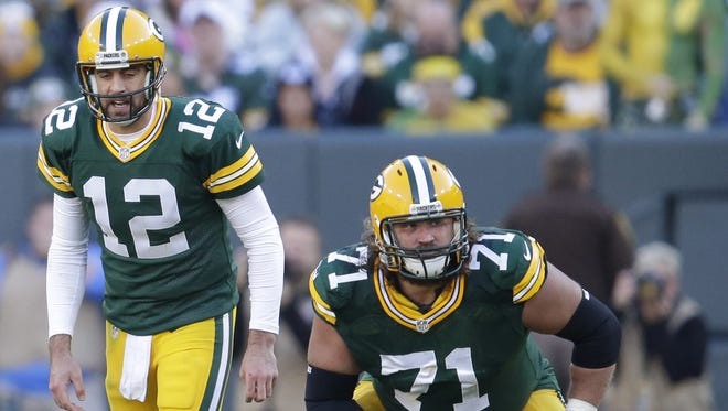 Green Bay Packers offensive lineman Josh Sitton prepares to block for quarterback Aaron Rodgers. Both players were nominated for Professional Athlete of the Year for the Wisconsin Sports Awards.    The Green Bay Packers host the Detroit Lions Sunday, November 15, 2015, at Lambeau Field in Green Bay, Wis.  Dan Powers/P-C Media