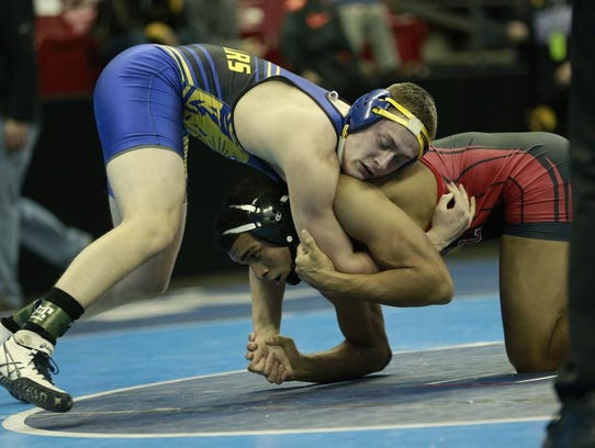 Campbellsport's Matt Koelbl battles Neillsville/Greenwood/Loyal's Stephen Buchanan in a 182-pound Division 2 consolation match Friday at the WIAA individual state wrestling tournament at the Kohl Center in Madison.