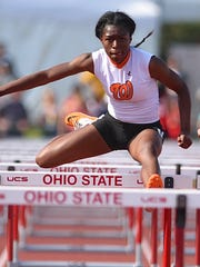 J'Alyiea Smith from Withrow competes in the 100 meter hurdles Friday at the Ohio Track and Field State Championship in Columbus.