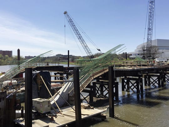The Park Road Bridge is under construction in Iowa City, where officials are spending $40 million to raise the bridge and Dubuque Street, which runs along the Iowa River.