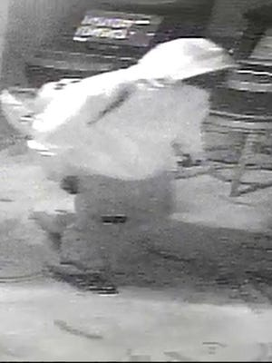 Surveillance video screen shot from armed robbery in Watertown on Saturday night.