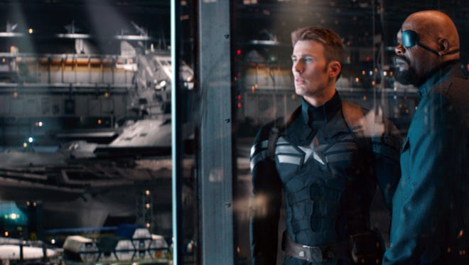 """Steve Rogers (Chris Evans) gets used to the modern world with the help of Nick Fury (Samuel L. Jackson) in """"Captain America: The Winter Soldier."""""""