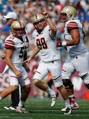 Boston College place kicker Mike Knoll (98) celebrates after making a field goal during the third quarter of an NCAA college football game against Massachusetts in Foxborough, Mass., Saturday, Sept. 10, 2016. Boston College won 26-7. (AP Photo/Michael Dwyer)