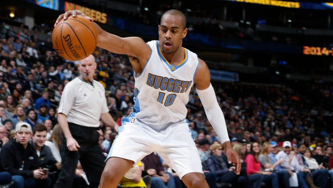 Denver Nuggets guard Arron Afflalo reaches out to save the ball from going out of play Jan. 7, 2015, in Denver.