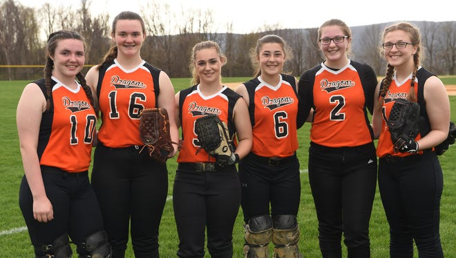 Three sets of sisters who all play on Dover's softball team. From left to right: Courtney Lundgren, Emily Lundgren, Mackenzie Taggart, Jess Taggart, Chelsea Yeno, and Dani Yeno.