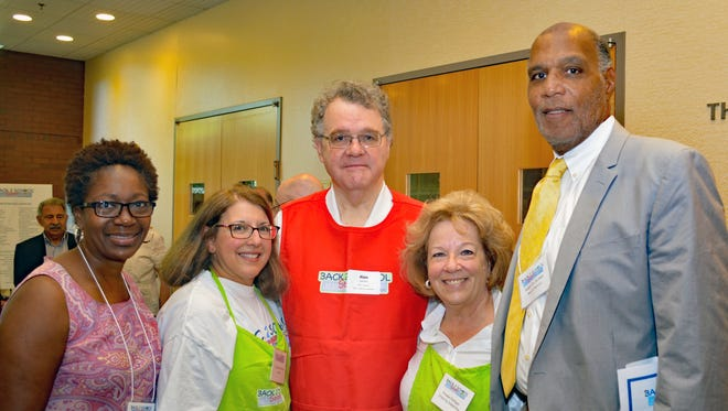 From left, Cheryl Jackson; Jill Sorkin Johnson, the Back 2 School Store co-chair; Alan Johnson; Phoebe Pollinger; and Mayor Robert D. Jackson, all Montclair residents, attend the ribbon-cutting ceremony for the Back 2 School Store sponsored by the National Council of Jewish Women, Essex County section.