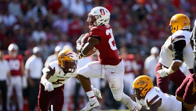 Bryce Love #20 of the Stanford Cardinal runs with the ball against the Arizona State Sun Devils at Stanford Stadium on September 30, 2017 in Palo Alto, California.