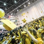Vestal graduates toss their caps into the air at last year's graduation ceremony at the Binghamton University Events Center.