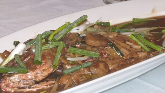 Sauteed braised whole fish is one of the traditional Chinese specialties offered by Red Ginger.
