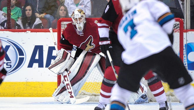 Arizona Coyotes goalie Mike Smith (41) watches the puck during the second period against the San Jose Sharks at Gila River Arena.