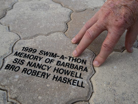 """Frank Haskell reflects on a memorial brick for his daughter Barbara Haskel at Golisano Children's Hospital Wednesday, November 8, 2017. Barbara was the inspiration for """"Barbara's Friends."""""""