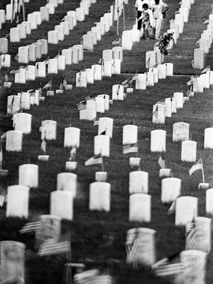 A family visits a loved one's grave at the National Cemetery on Gallatin Road during Memorial Day, May 31, 1976.