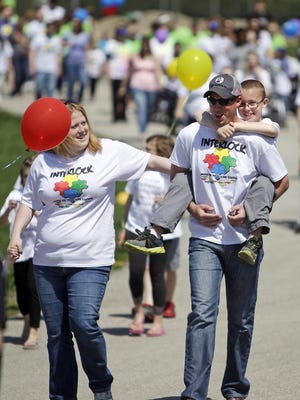 Families join in a past Interlock Autism Walk at the Delaware County Fairgrounds in this file photo.