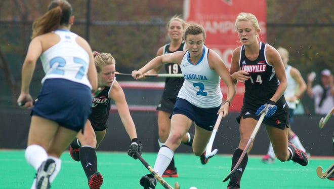 UNC's Loren Shealy (2) tries to escape the tight defense of U of L's Alyssa Voelmle (10) and Hailey Netherton (14). September 20, 2014.