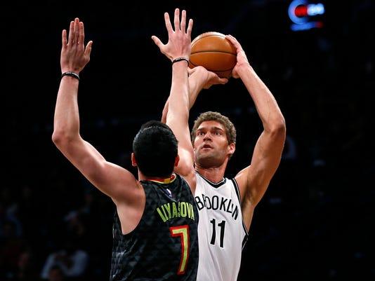 Brooklyn Nets center Brook Lopez (11) shoots over Atlanta Hawks forward Ersan Ilyasova (7) during the first half of an NBA basketball game Sunday, April 2, 2017, in New York. (AP Photo/Adam Hunger)