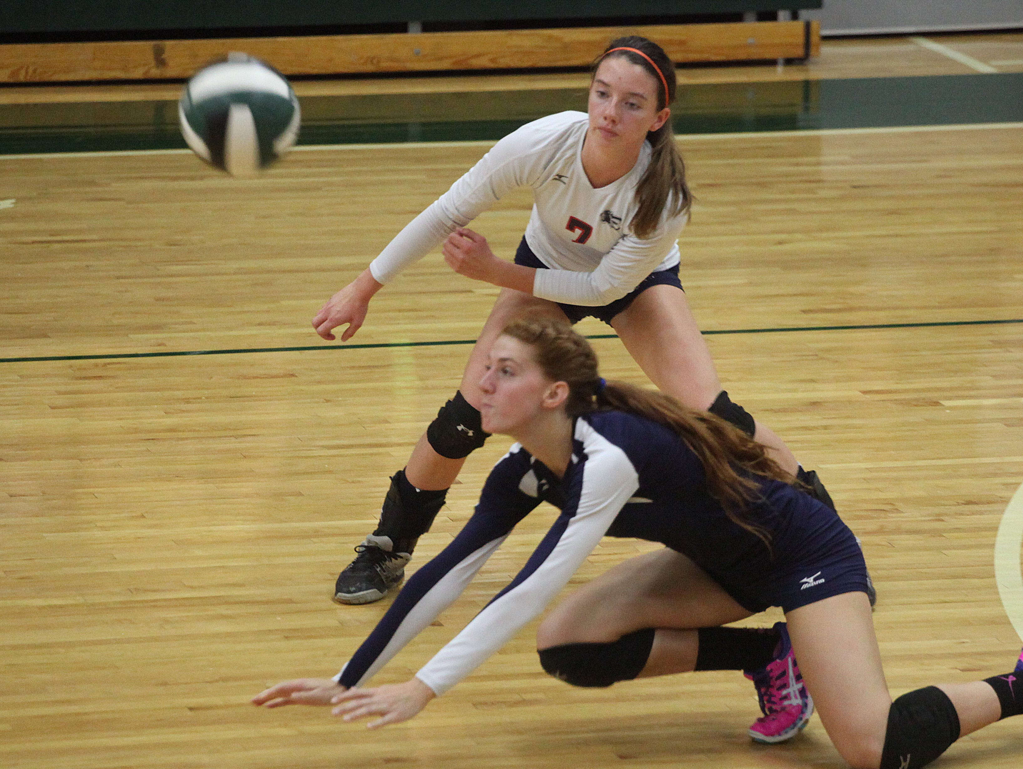Estero's Lily Ciaramitaro, front, and Marley Garner attempt to save a point during the 6A-11 volleyball final at Fort Myers High School on Thursday.