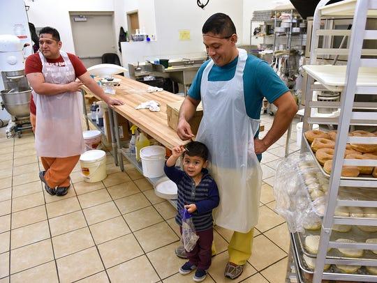 Jaime Alvarez, left, and Gerardo Urbano and his son
