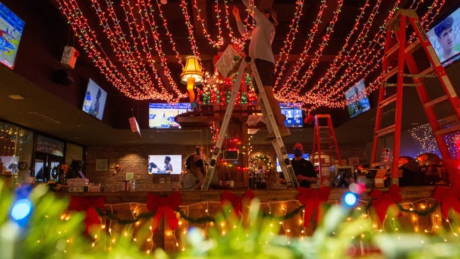 Staff at The Pennant, 915 S. Kansas Ave., decorate the upstairs bar Tuesday to turn it into a holiday-themed pop-up called Mistletoe complete with lights, presents and cheerful decorations.