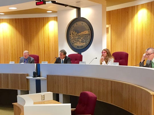 State Land Board members approved two deals Monday that put more land under state control.
