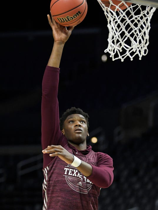 Texas A&M forward Robert Williams shoots during practice at the NCAA men's college basketball tournament, Wednesday, March 21, 2018, in Los Angeles. Texas A&M plays Michigan in a regional semifinal on Thursday. (AP Photo/Mark J. Terrill)