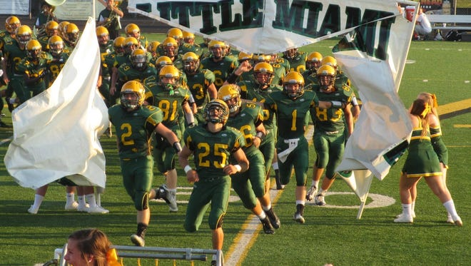 Brayden Thornbury (center) leads Little Miami onto the field the night before his accident.