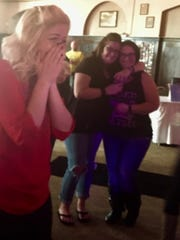 Carleigh Hager reacts to a gift at a benefit hosted for her on Jan. 21 after she was brutally attacked by her now ex-boyfriend.