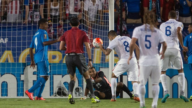 United States forward Clint Dempsey scores a header goal past Honduras goalkeeper Donis Escober during the first half of the 2015 Gold Cup soccer match at Toyota Stadium.