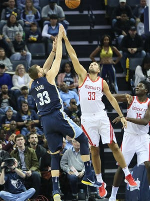 Oct 28, 2017; Memphis Grizzlies center Marc Gasol (33) shoots the ball over Houston Rockets forward Ryan Anderson (33) in the first quarter at FedExForum.