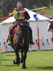 """David Schade as """"Sir William Dudley"""" performs at the Medieval Faire at Lakes Park in south Fort Myers."""