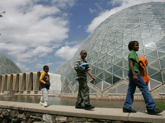 Micah Curd, 4 (left), his stepbrother, Ronald Morgan, 8, and sister Corey Curd, 9, make their way home after an afternoon in the Mitchell Park Domes in May 2005.