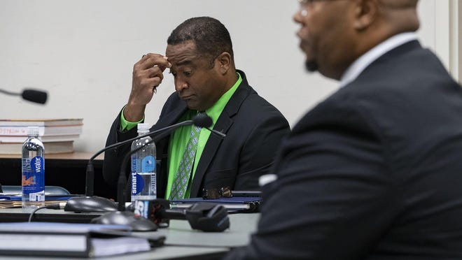 Fired Spanish River High Principal William Latson listens as Superintendent Donald Fennoy testifies during an administrative court hearing in February at which Latson was trying to get his job back.