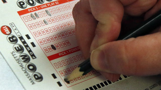 A customer fills out a Powerball lottery ticket at a convenience store.