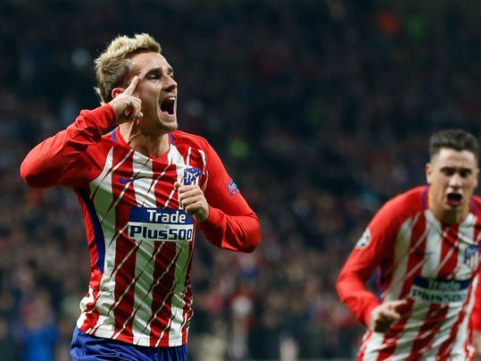 Atletico's Antoine Griezmann celebrates scoring the opening goal during a Champions League group C soccer match between Atletico Madrid and Roma at the Wanda Metropolitano stadium in Madrid, Wednesday, Nov. 22, 2017. (AP Photo/Francisco Seco)