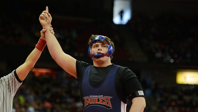 Southern Door's Mitchell Overbeck reacts after defeating Cedar Grove-Belgium's Danny Gjertson in their 285-pound Division 2 quarterfinal match during the WIAA individual wrestling state tournament Friday at the Kohl Center in Madison. Evan Siegle/Press-Gazette Media