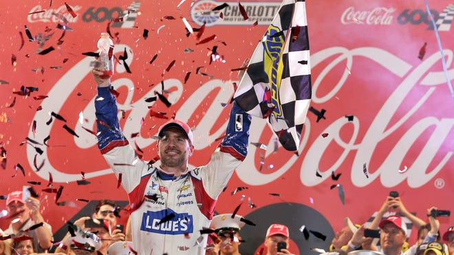 Jimmie Johnson celebrates in Victory Lane after winning the Coca-Cola 600 at Charlotte Motor Speedway on Sunday.