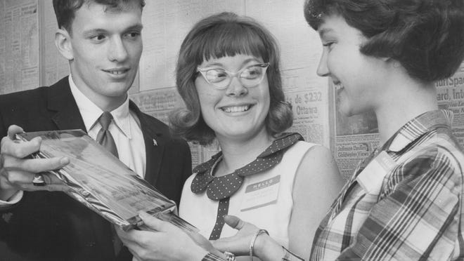 Timothy McGinn of Scecina High School and Sandy SerVaas (center) of Broad Ripple High School, Teen Star correspondents, receive a plaque of appreciation from Gretchen Wolfram, Teen Star editor. The Teen Star was a section by, for and about area high school students.