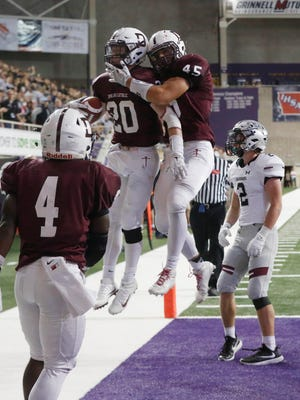 Dowling CatholicÕs Jack Koerner and Dowling CatholicÕs Jake Hummel celebrate after Koerner intercepted a ball meant for Ankeny Centennial in the end zone Friday, Nov. 11, 2016, during their 4A state semifinal game at the UNI Dome in Cedar Falls.
