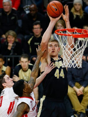 Jan 18, 2016; Piscataway, NJ, USA; Purdue Boilermakers center Isaac Haas (44) shoots over Rutgers Scarlet Knights guard Justin Goode (10) and forward Greg Lewis (35) during second half at Louis Brown Athletic Center. Purdue Boilermakers defeated the Rutgers Scarlet Knights 107-57. Mandatory Credit: Noah K. Murray-USA TODAY Sports