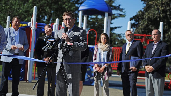 Sioux Falls Mayor Mike Huether speaks during a ribbon cutting to celebrate the renovation of Spellerberg Park Monday, Oct. 3, 2016, in Sioux Falls.