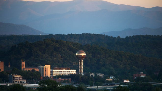 The Sunsphere stands in front of the Smoky Mountains, as seen from Sharps Ridge Memorial Park in North Knoxville on Monday, May 1, 2017.