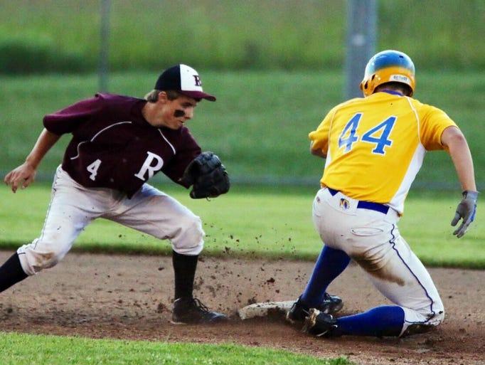 Elkhart Lake's Brennan Cain (4) tries to tag Howards Grove's Brad Olson (44) out at second base Tuesday July 15, 2014 at Howards.