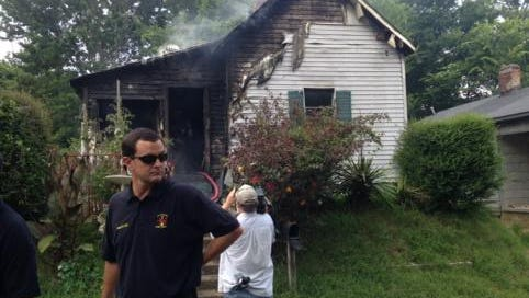 Fire crews worked to put out a house fire started by a lawnmower on Taylor Street on Wednesday.