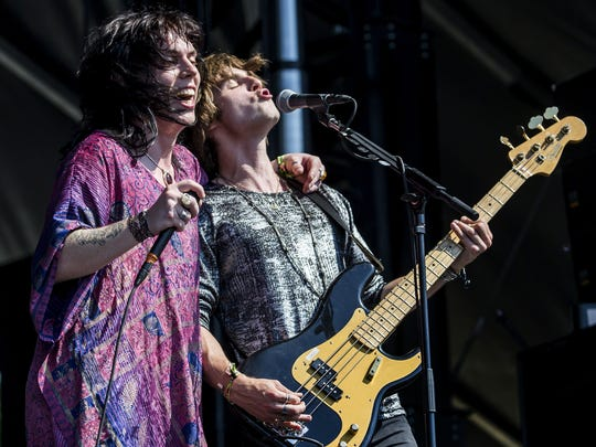 The Struts singer Luke Spiller (left) and bassist Jamie Binns perform on the Lawn Stage at the Firefly Music Festival in June.