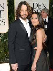 Musician Chris Cornell and wife Vicky Karayiannis arrive at the 69th Annual Golden Globe Awards held at the Beverly Hilton Hotel on January 15, 2012 in Beverly Hills, California.