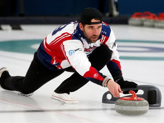 In this Jan. 3, 2019 photo, former Minnesota Vikings football player Jared Allen practices with his curling team for a competition in Blaine, Minn. Allen retired from the NFL in 2015 and wasn't ready to give up on the competition he'd come to enjoy as a five-time All-Pro in a 12-year career. His solution: Make it to the 2022 Olympics _ in curling. Less than a year later, he and three other former NFL players who have never curled before will attempt to qualify for the U.S. championships against curlers who have been throwing stones for most of their lives. (AP Photo/Jim Mone)